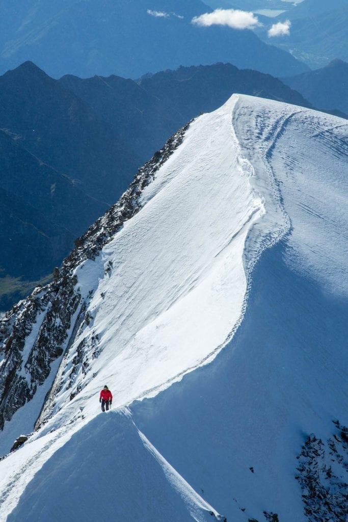 Traversing a snowy peak towards the Weissmies