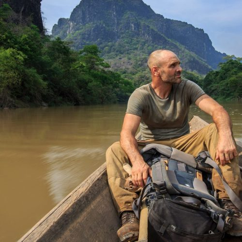 Ed Stafford cruising down a river in Laos