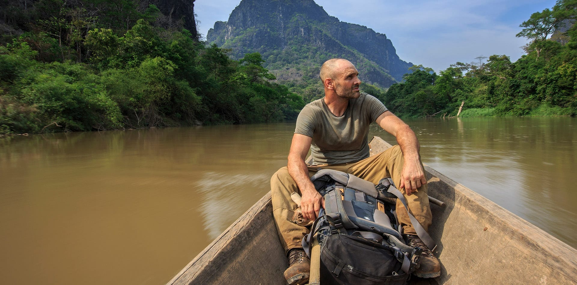 Ed Stafford cruising down a river in Laos
