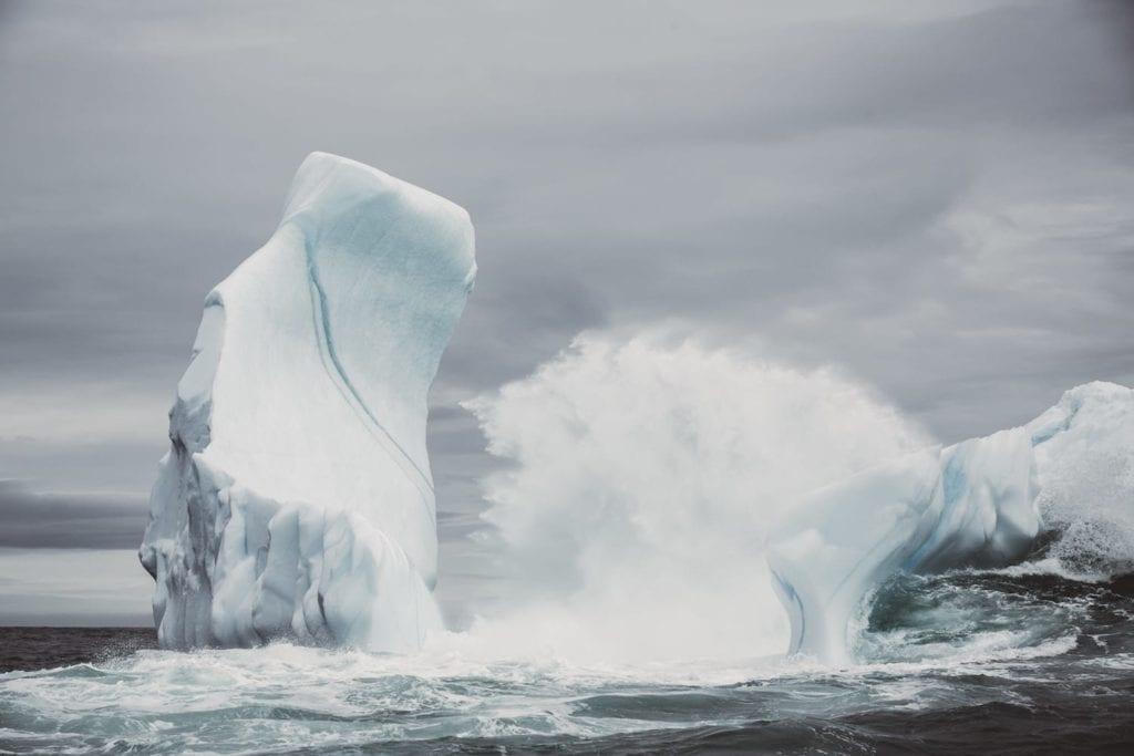 Heavy waves break over a grounded Iceberg