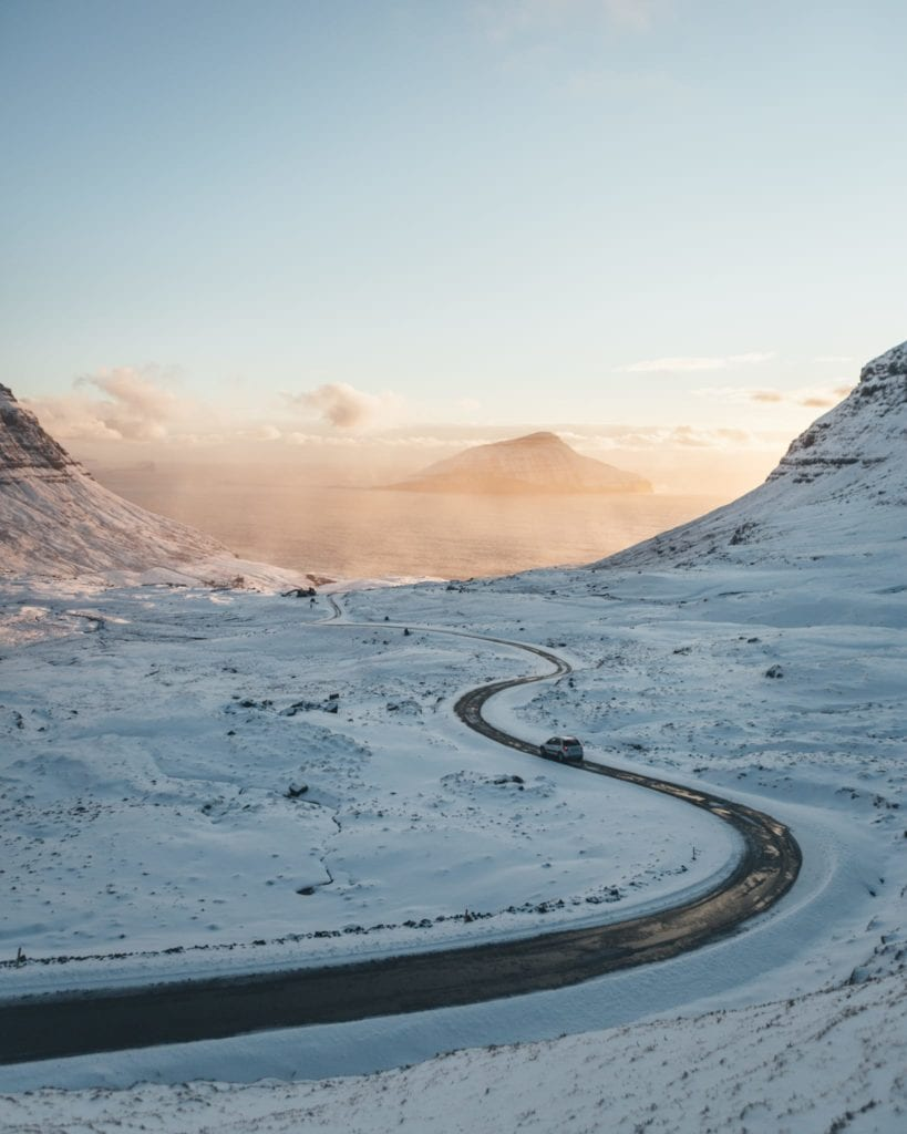 A dreamy shot captured by Vang of a road winding through the snow