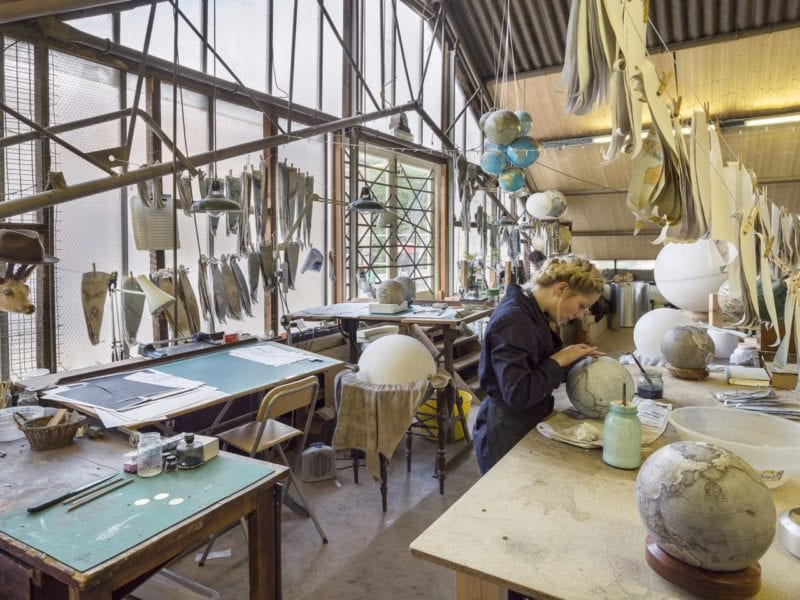artisan globe maker at work