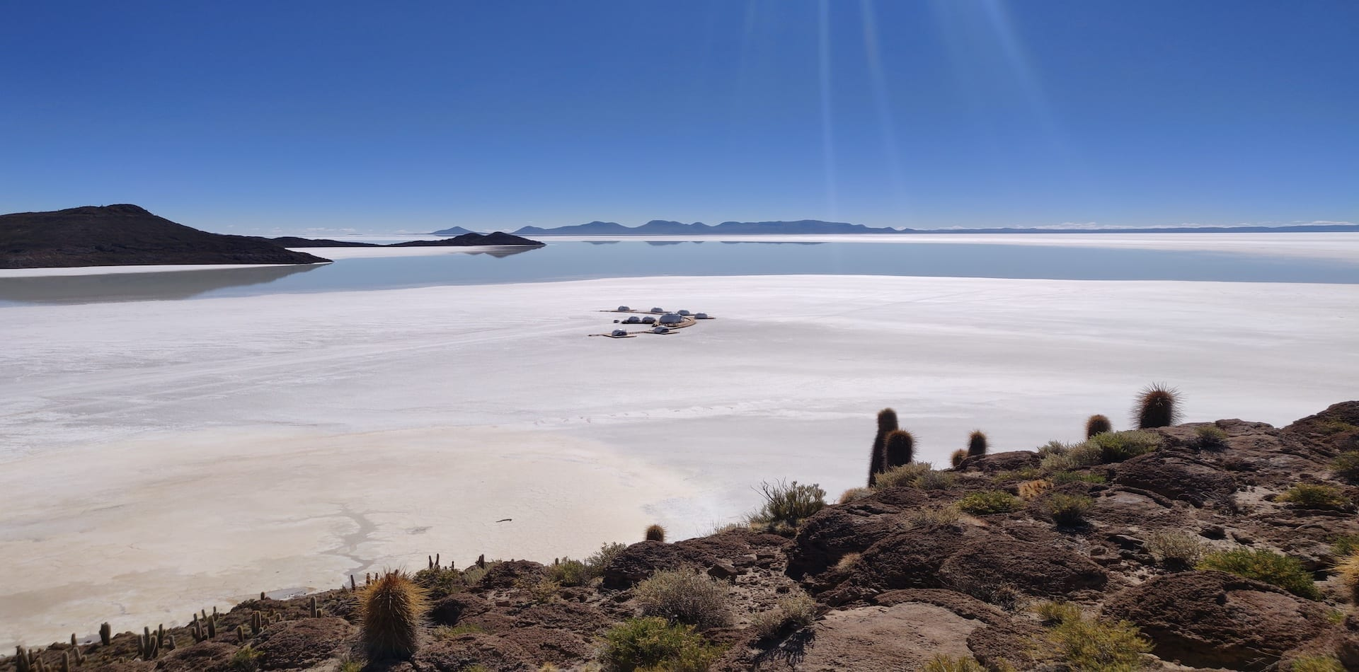luxury pods in the distance on the salt flats