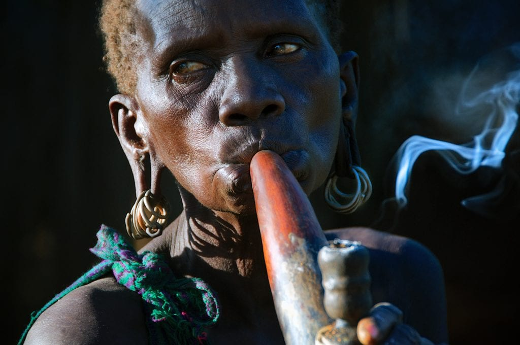 an intimate photo of a tribal woman from the Mursi tribe