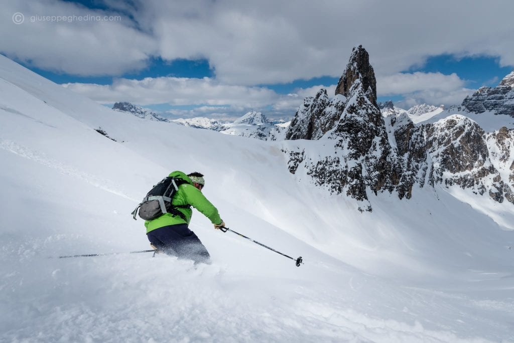 a skier making the most of the powder