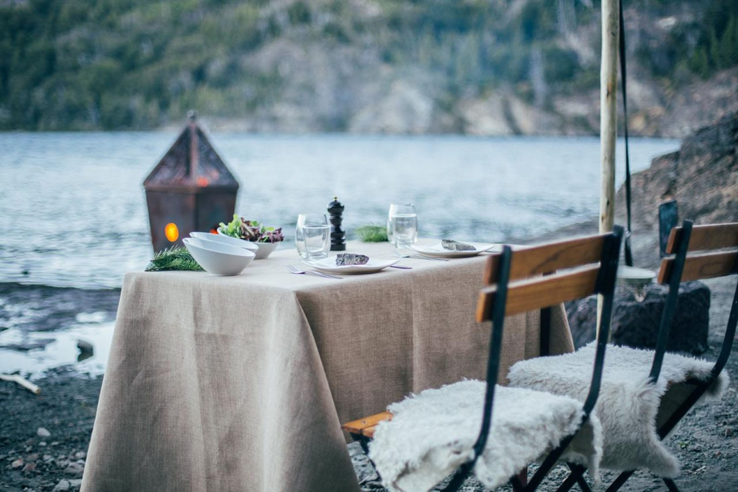 table for two under canvas looking over the glacial lake