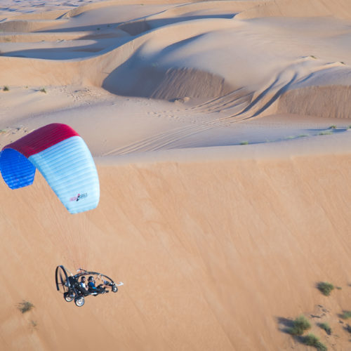 ultimate desert adventure, gliding over dunes