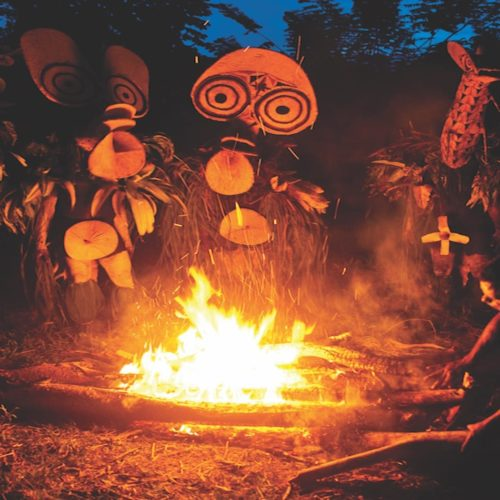 tribe gathers around fire pit