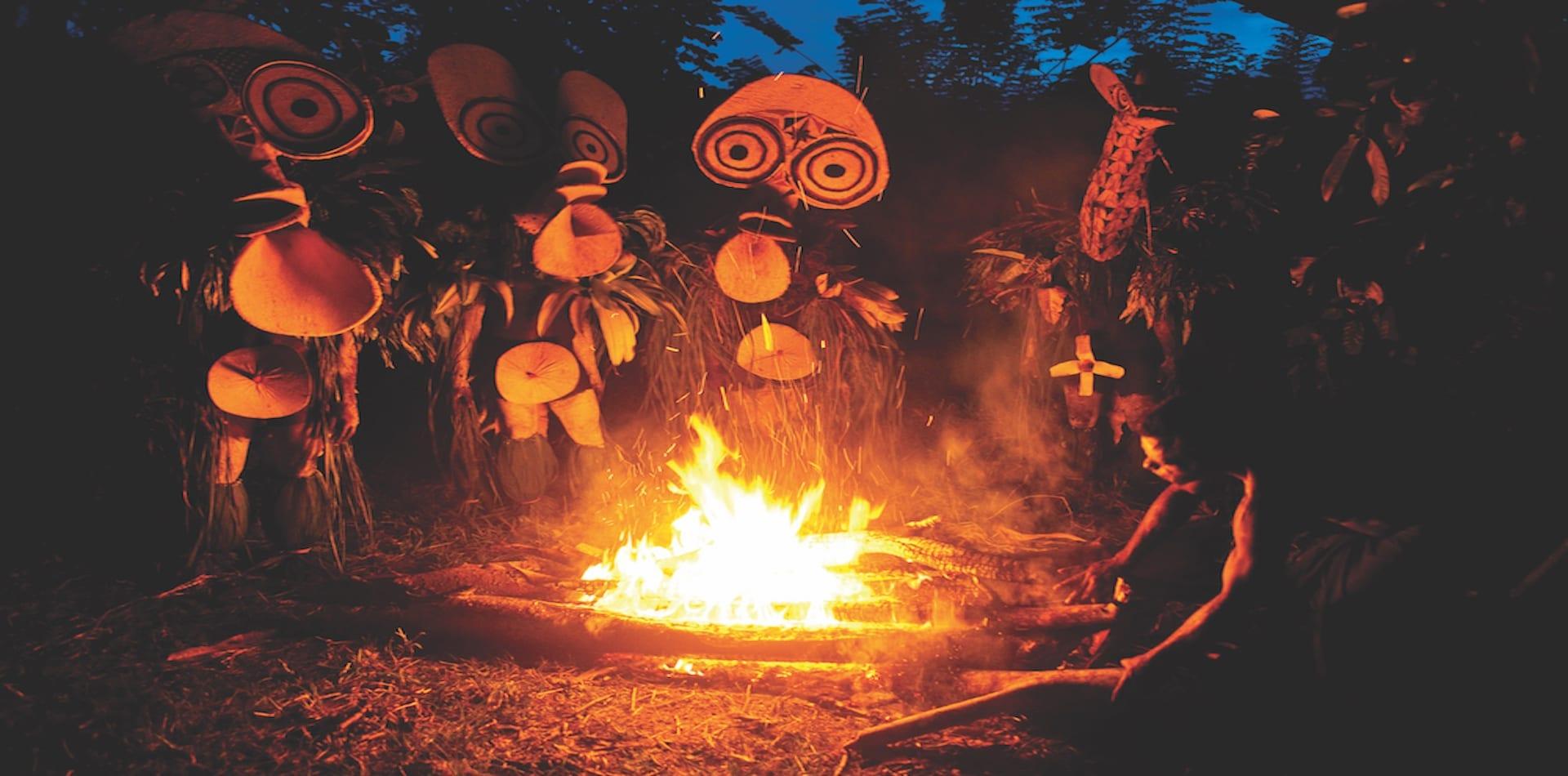 tribe gathers around fire pit