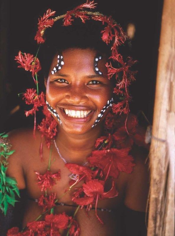 smiling tribal woman wearing a flower headdress