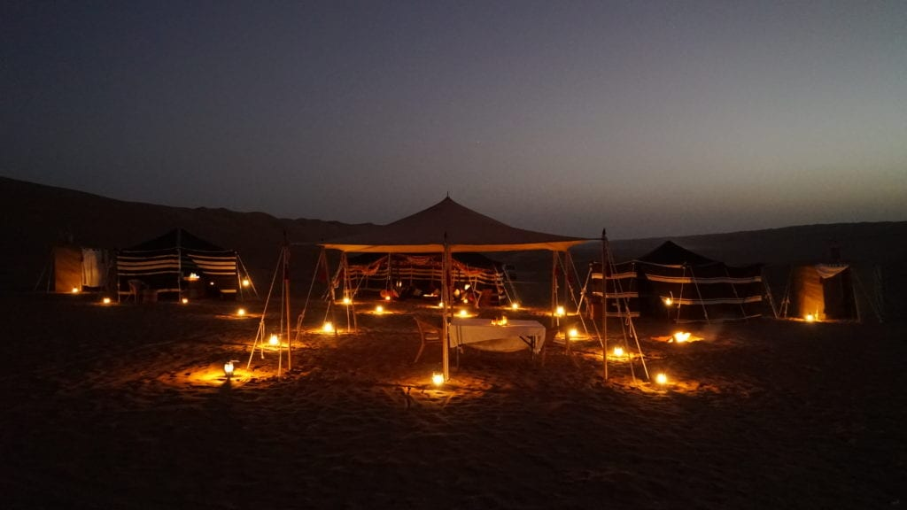 luxury camp lit up at night