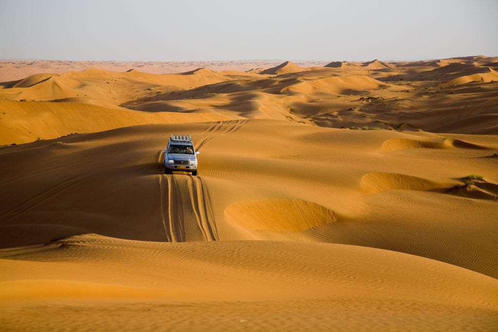 vehicle traversing Wahiba Sands further into wilderness
