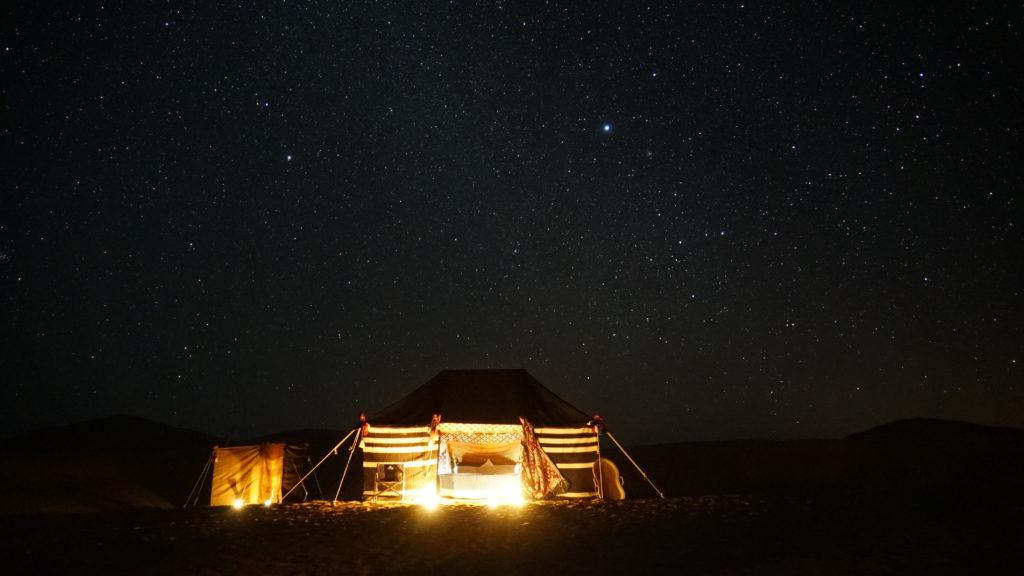 camp under a constellation strewn sky