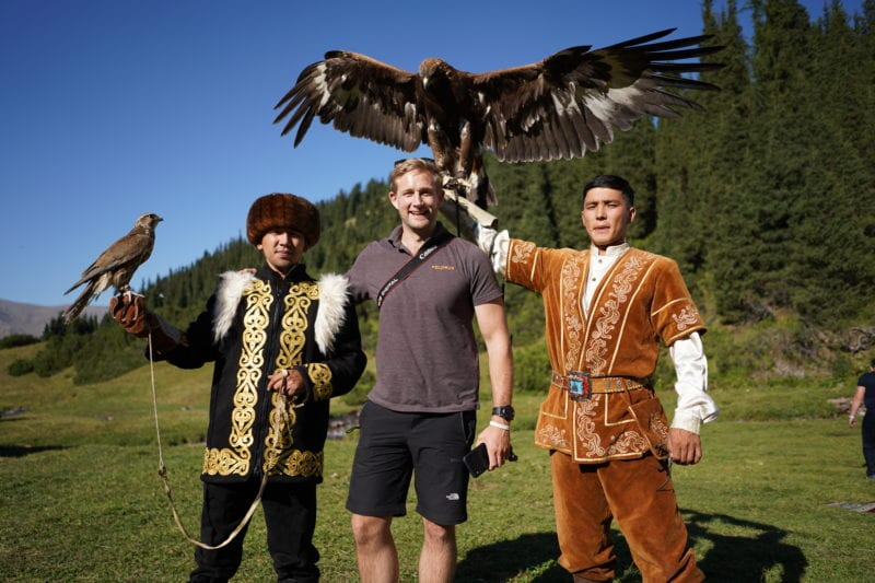 Cultural tradition - two hunters in traditional dress armed with a Golden Eagle and Kazak Falcon