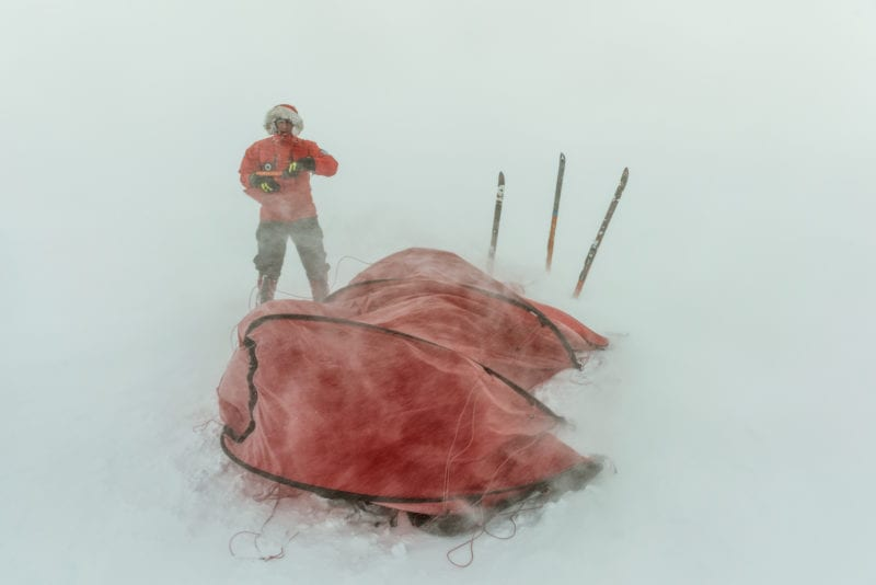 Rudd battles the conditions to set up his tent