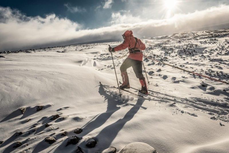 Skiing across rocky terrain
