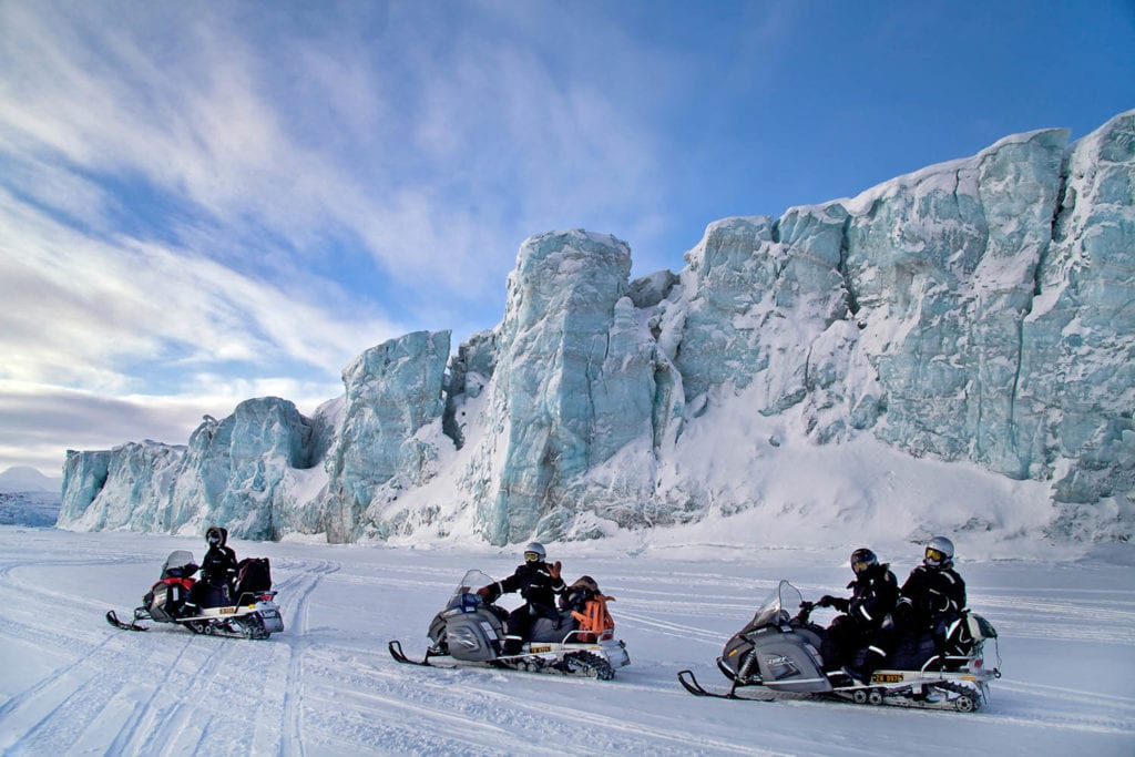 Traversing the ice on snowmobiles in search of Polar Bears