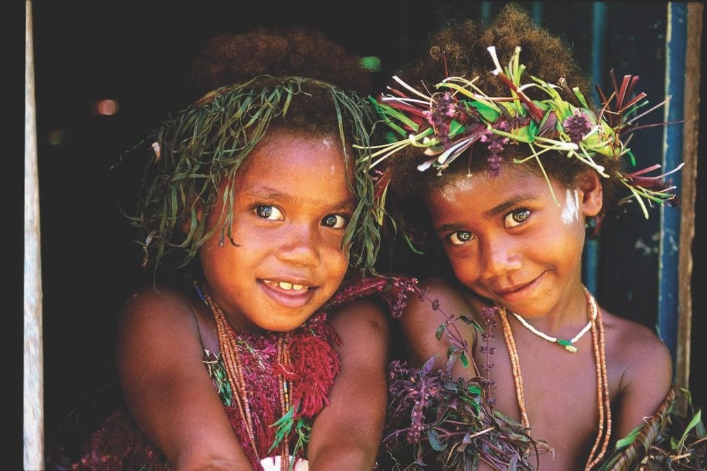 Tribal kids wear jewellery, paint and headdress for their celebration