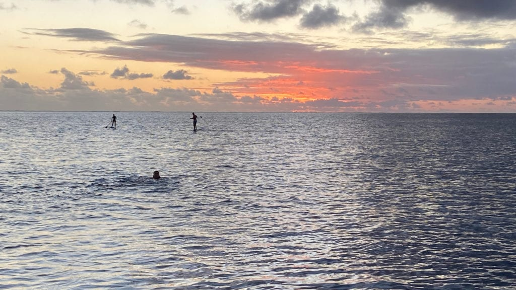 Paddleboard on flat waters at sunset