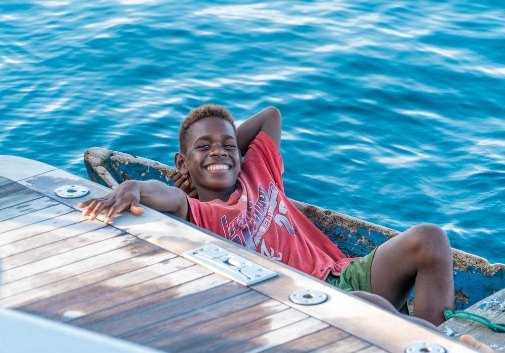Solomon Islands boy in kayak