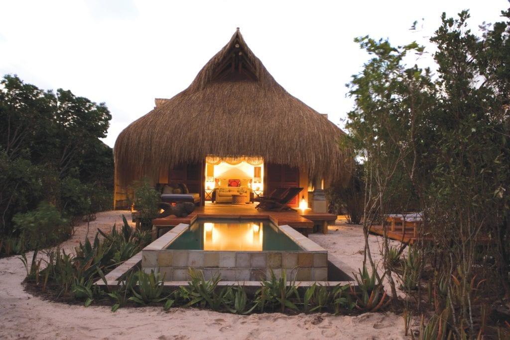 Infinity Beach Villa Exterior at Dusk Azura Benguerra Mozambique