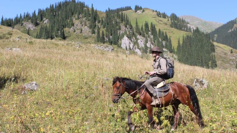 Geordie Mackay-Lewis horesback in Kazakhstan