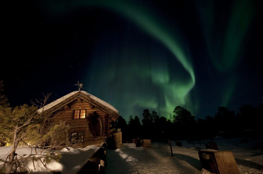 Aurora Borealis over accommodation in Norway