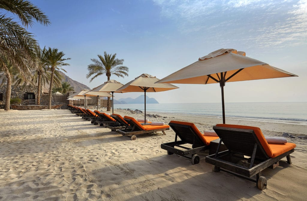 Six Senses Zighy Bay private beach with sun loungers Oman