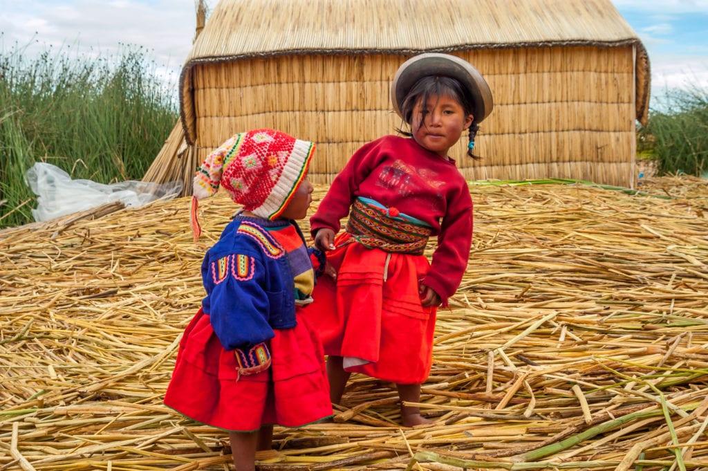Native Children of The Uros Floating Island Lake Titicaca in Peru
