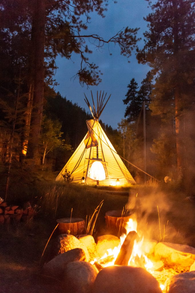 Tipi at Night with Fire pit at Taylor River Lodge Colorado North America