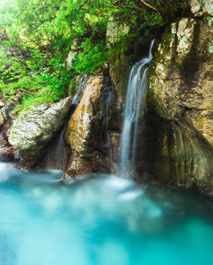 Waterfall in the Mountains in Slovenia Adventure