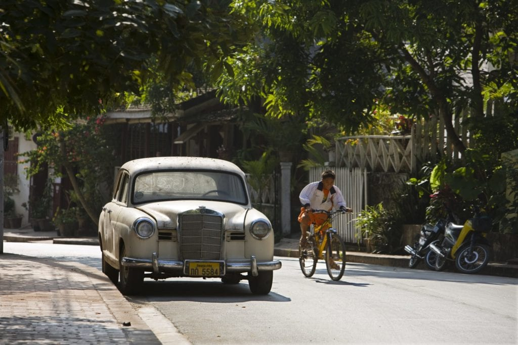 luang prabang street and cyclist laos