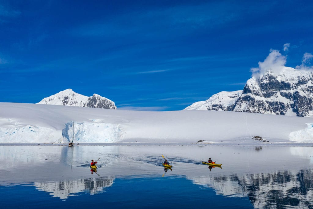 Antarctica Kayaking Blue Skies Mountains
