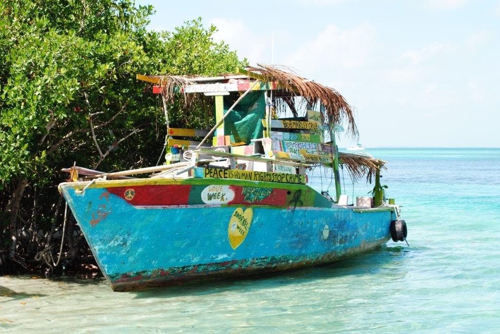 boat moored in water in belize