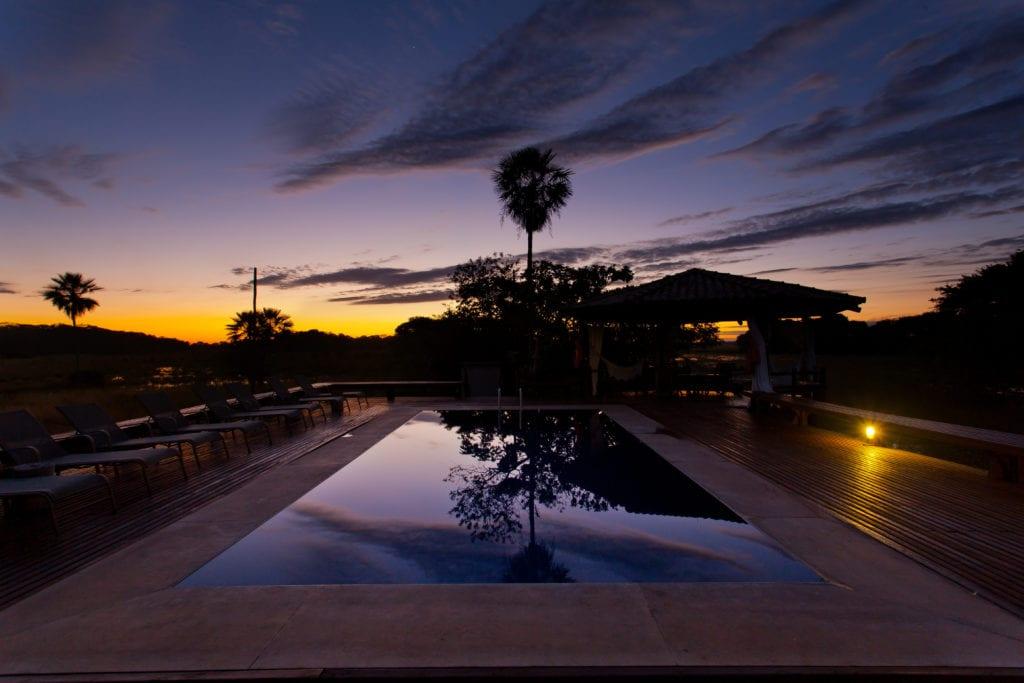 Swimming pool at sunset Caiman Ecological Refuge Brazil
