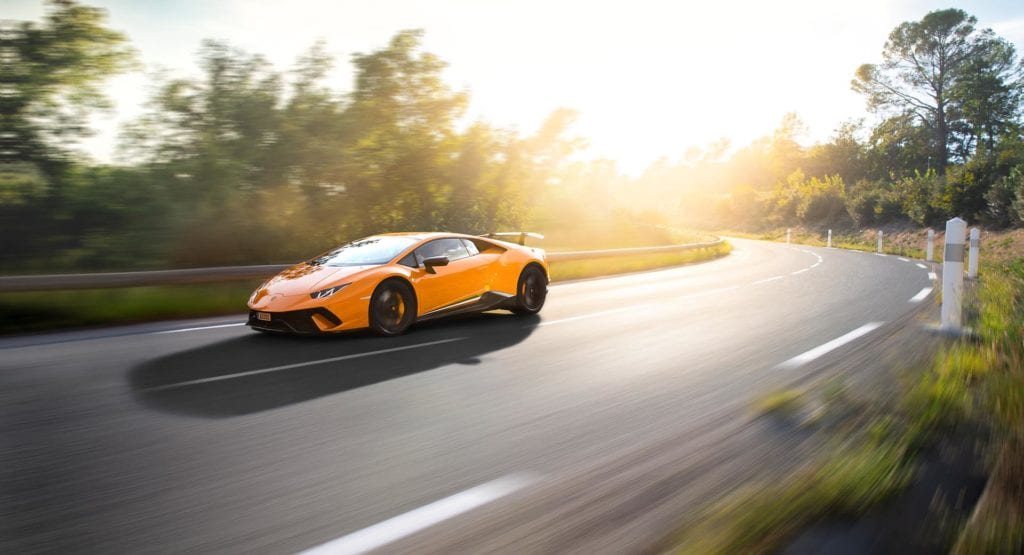 Orange Supercar in the Swiss Alps