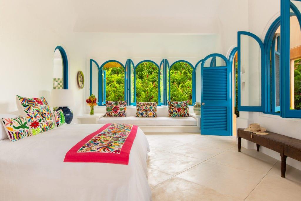 casa cuixmala bedroom blue shutters