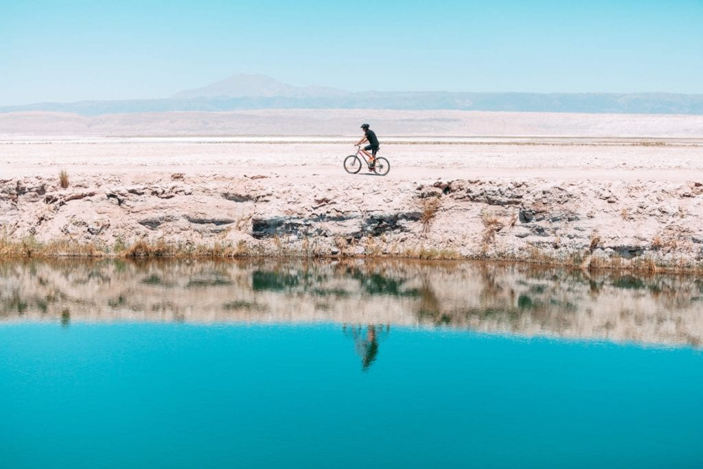 Cyclist reflected in one of Chile's lakes