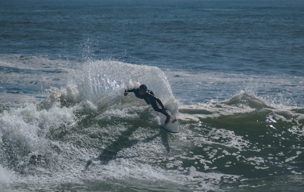 Surfing at a beach in Chile