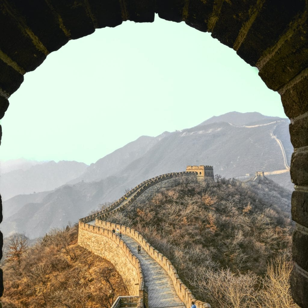 View of the Great Wall of China through an archway