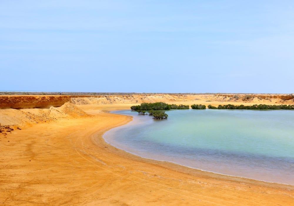 Desert sands meets azure lagoon, Colombia