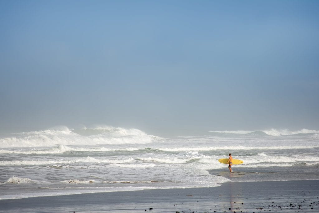 A surfer enters the sea in Costa Rica