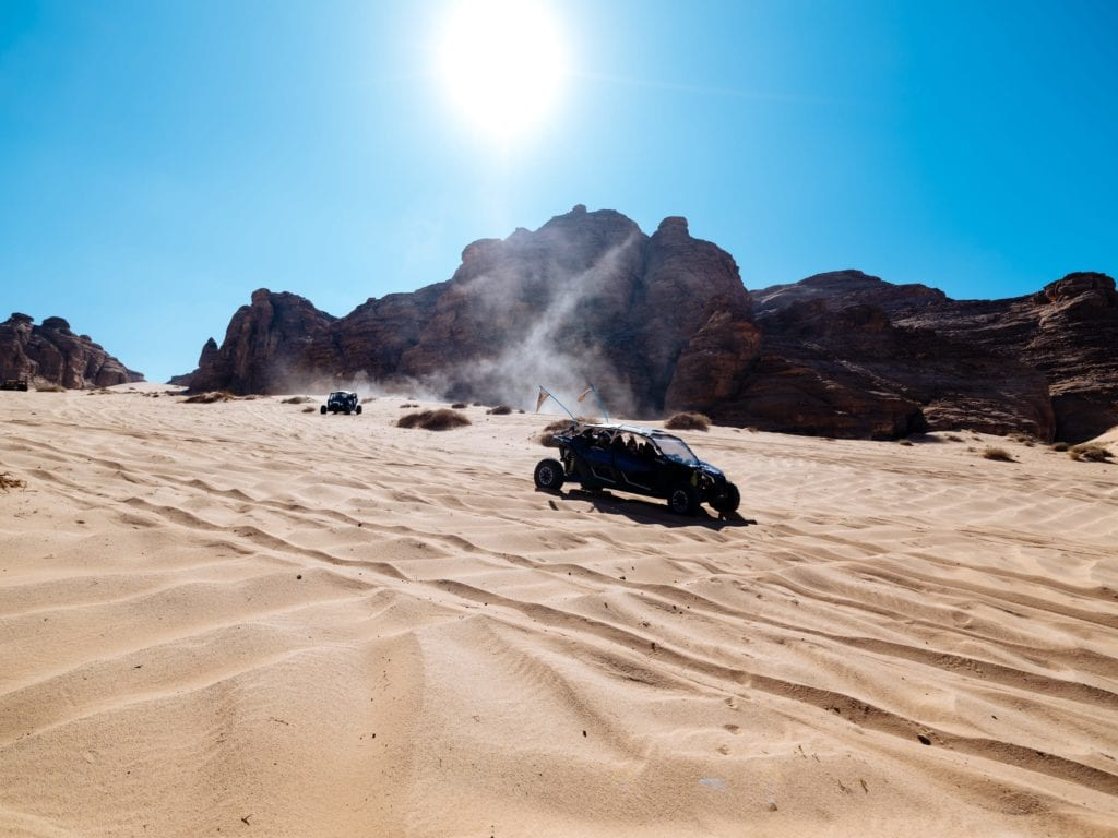 race around the sand dunes in desert buggies