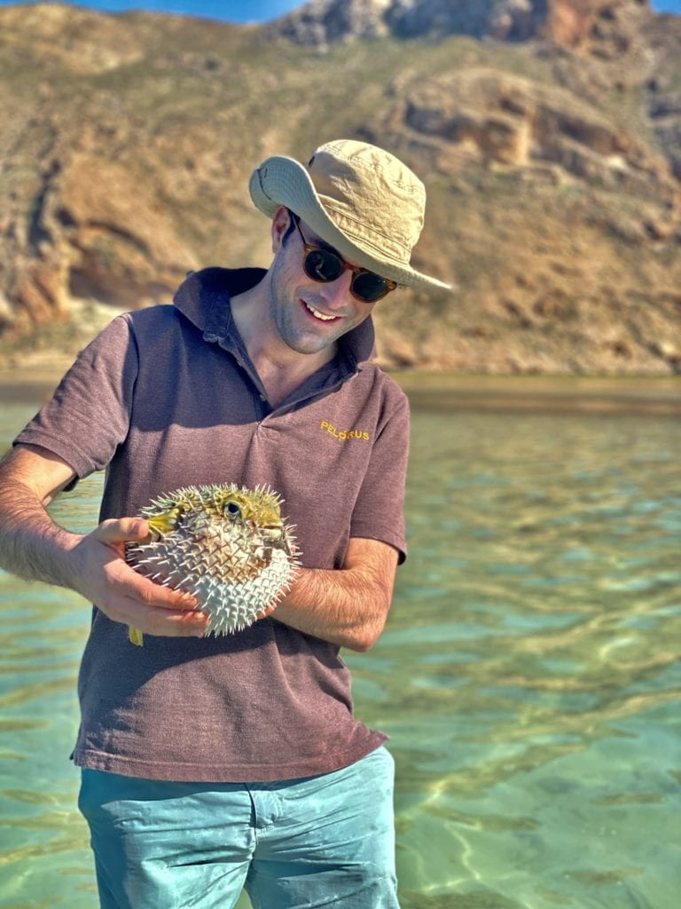 Pelorus founder Geordie holding an exotic fish