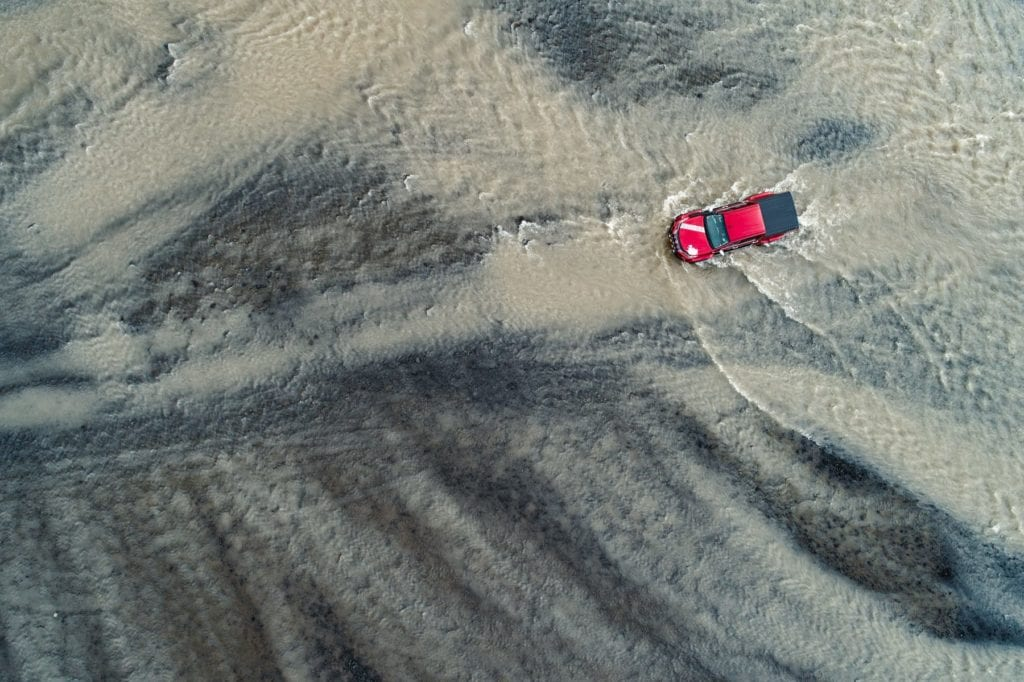 Iceland aerial of driving through water
