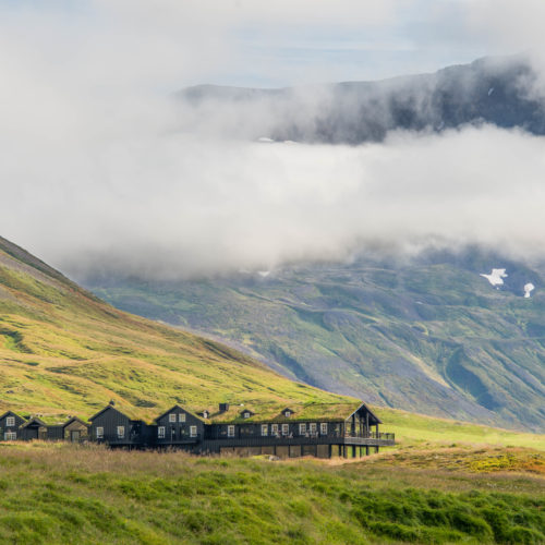 Traditional buildings on green hills in Iceland