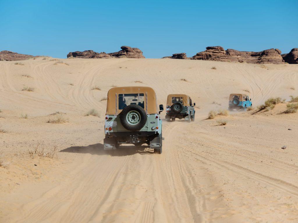 Landrovers in convoy across the sand dunes, Saudi Arabia