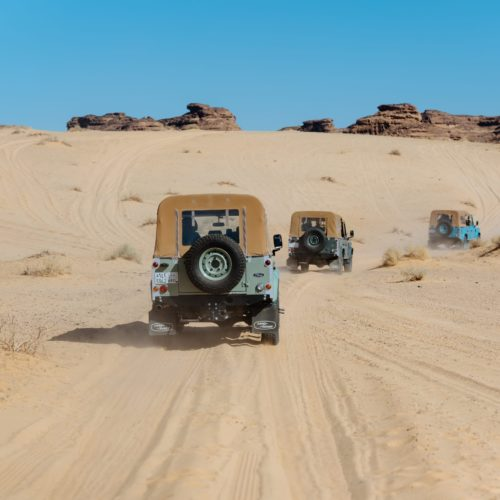 Landrovers in convoy across the sand dunes, Saudi Arabia
