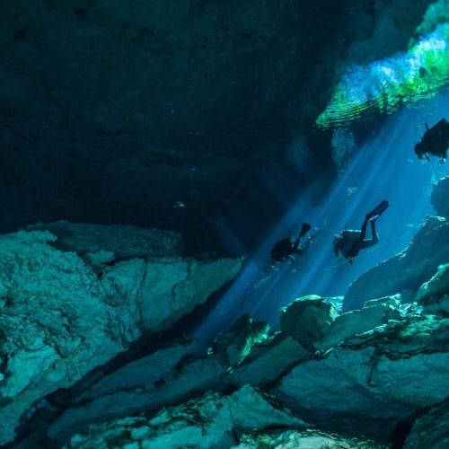 scuba diving through caves in mexico