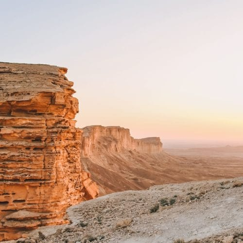 sunset falls upon Saudi's intricate rock formations